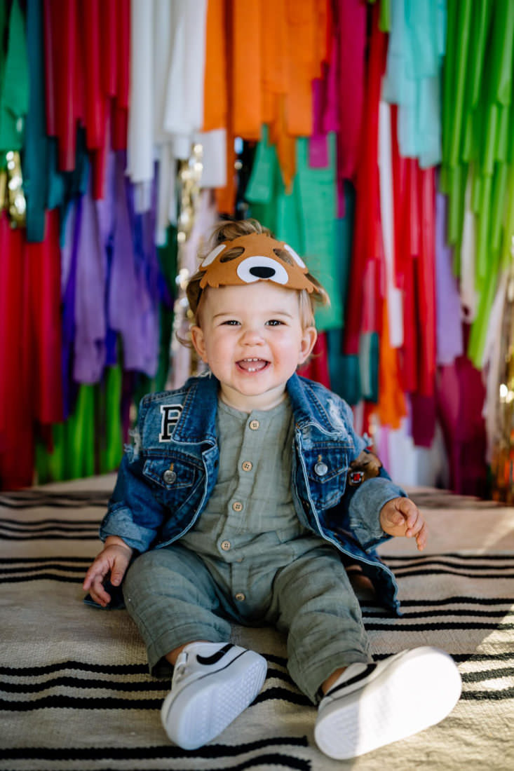 Babies first birthday photography with bear mask on