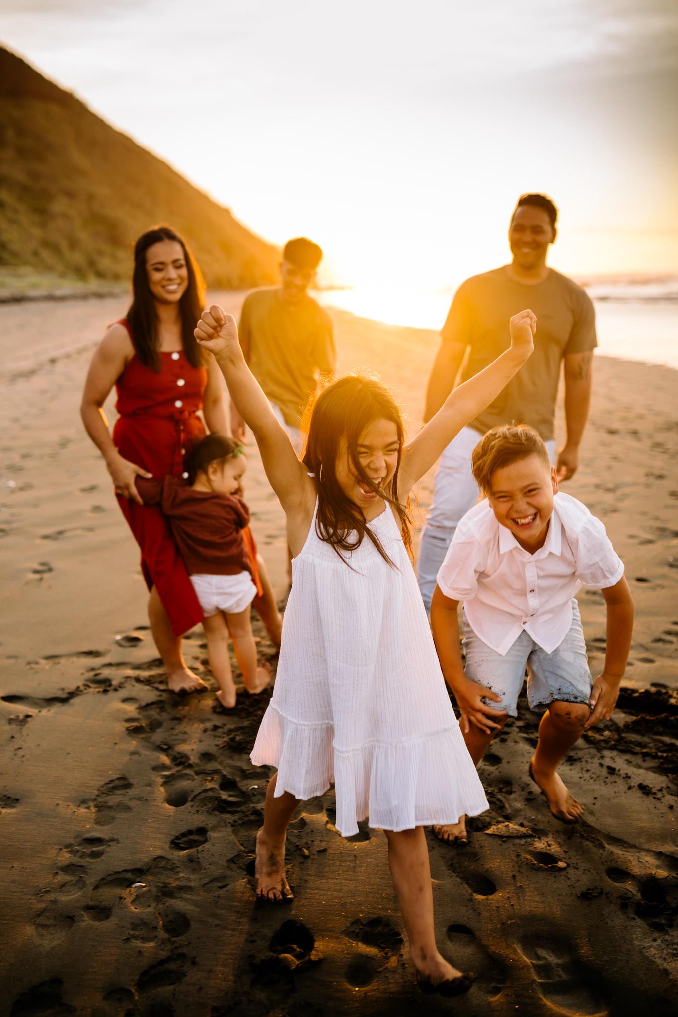 Family at Raglan Beach sunset photo